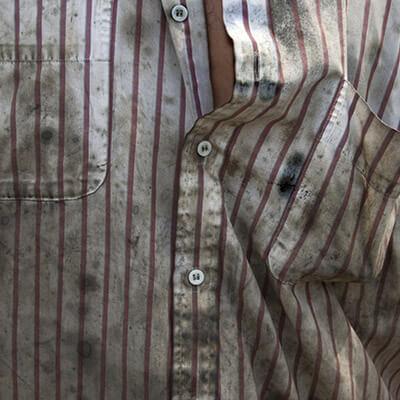 Karrenschmiere an Textilien